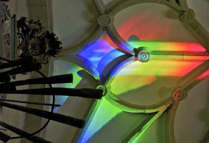 mixed colors on ceiling in rainbow light art installation.